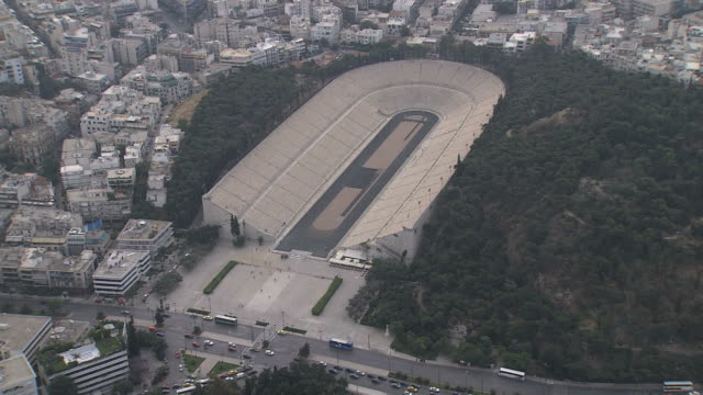 ms aerial zo shot of the roman stadium / athens, greece - athens greece stock videos and b-roll footage