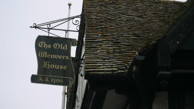 Shot of the sign for the Old Weavers House public house.