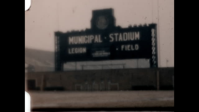 shot of the signage for the legion field municipal stadium at the end of a home movie reel. the film sputters and gets distorted. - grobkörnig stock-videos und b-roll-filmmaterial
