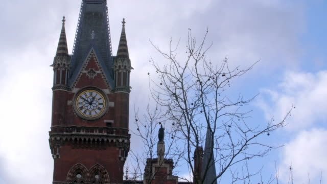 shot of the st pancras hotel's clock tower. - clock face stock videos & royalty-free footage