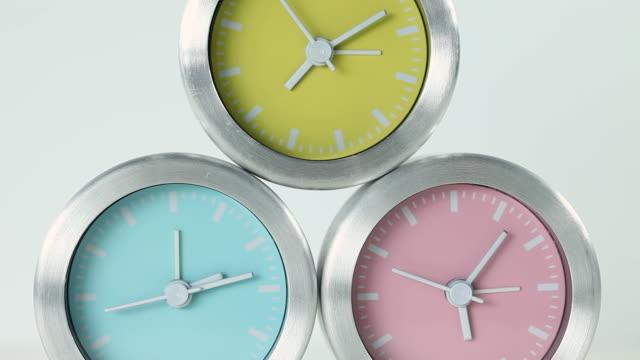 cu shot of three clocks / seoul, south korea - three objects stock videos & royalty-free footage
