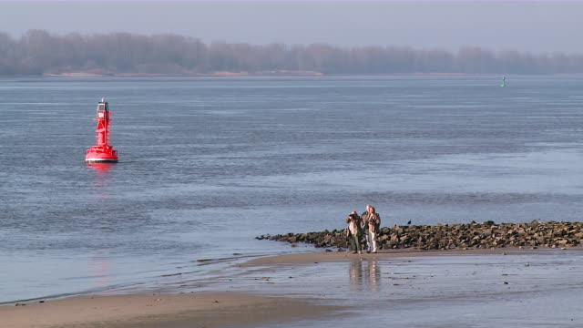 MS Shot of three people enjoying at river Elbe near Blankenese / Hamburg, Germany
