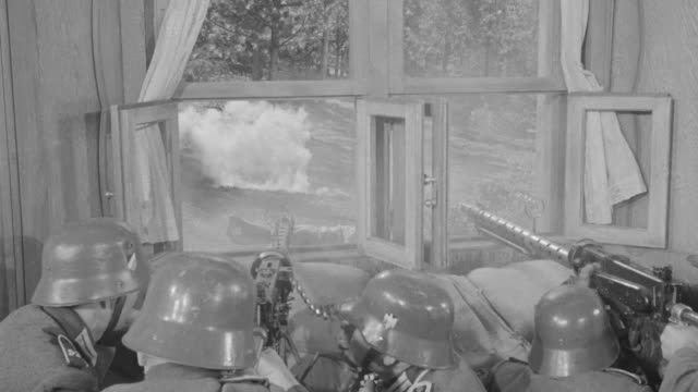 stockvideo's en b-roll-footage met ms shot of three soldiers with machine gun pointed and shooting out of window in forest and firing - nazisme