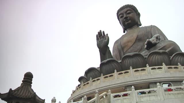 ms pan shot of tian tan buddha / hong kong, hong kong, china - tian tan buddha stock videos and b-roll footage