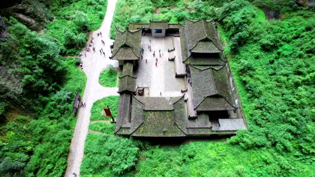 ws aerial shot of tianfu post house in wulong karst landform in chongqing, china - ravine stock videos & royalty-free footage