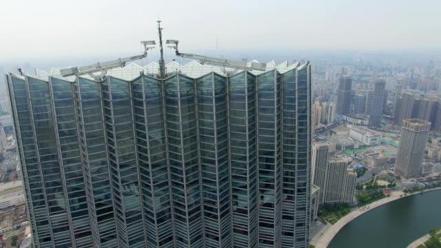 vídeos de stock, filmes e b-roll de aerial shot of tianjin world financial center and cityscape/tianjin,china - tianjin