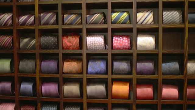 MS TU Shot of Ties rolling up inside store / Potsdam, Brandenburg, Germany