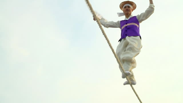 ms ts la shot of tightrope walker doing acrobatics on high wire / gyeonggido, south korea - fan enthusiast stock videos & royalty-free footage