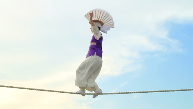 MS PAN Shot of tightrope walker doing acrobatics on high wire / Gyeonggido, South Korea