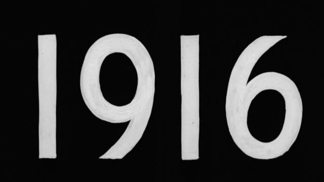 cu shot of title slate 1916 - 1916年点の映像素材/bロール