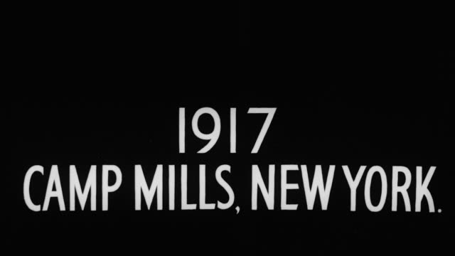 cu shot of title slate 1917 camp mills, new york - world war i stock videos and b-roll footage