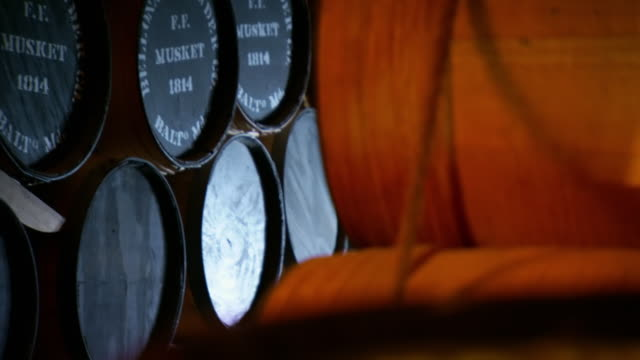 ms tu shot of to reveal barrels of gun powder stacked on top of each other at fort mchenry powder room / baltimore, maryland, united states  - gunpowder explosive material stock videos & royalty-free footage