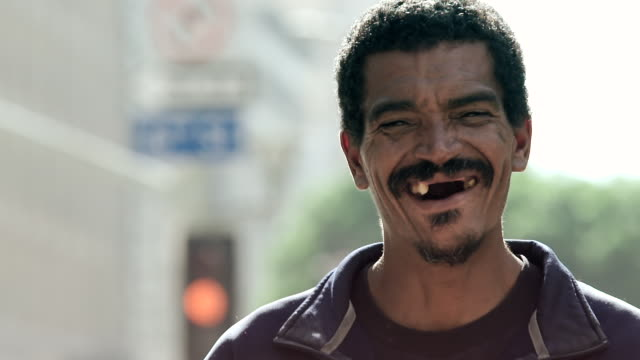 CU Shot of toothless man smiling and laughing genuinely / Los Angeles, California, United States