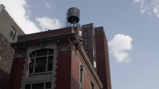 la shot of top of firehouse used in ghostbusters movie - feuerwache stock-videos und b-roll-filmmaterial