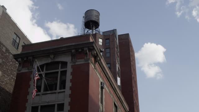 vídeos y material grabado en eventos de stock de la shot of top of firehouse used in ghostbusters movie - parque de bomberos