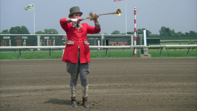 ms shot of tote bugler on monmouth horse race track - bugle stock videos and b-roll footage