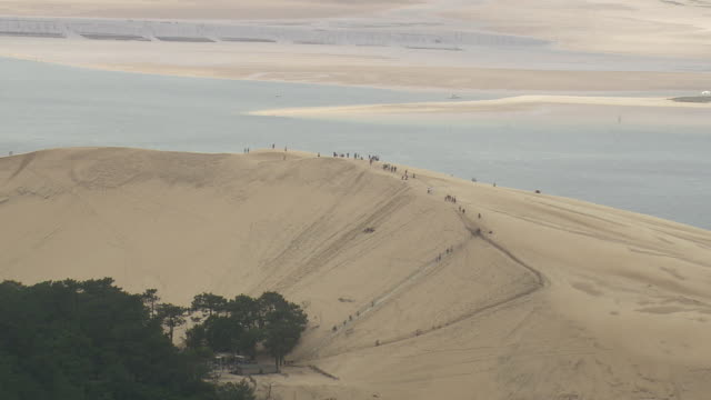 ws aerial zo shot of tourist at dune du pilat view of coast / aquitaine, france - dune of pilat stock videos and b-roll footage