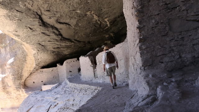 ms shot of tourist at gila cliff dwellings national monument / catron, new mexico, united states - cliff dwelling stock videos & royalty-free footage