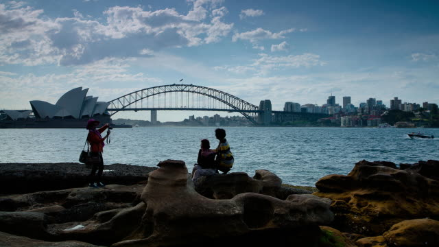 MS TU T/L Shot of tourist taking photo in front of harbor bridge / Sydney, new south wales, Australia