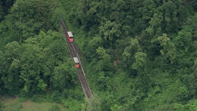 vidéos et rushes de ws aerial zi zo ts shot of tourist train travelling from town montreux / vaud, switzerland - montreux