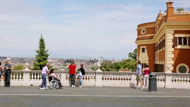 ms zo shot of tourists and people enjoying view from gianicolo (janiculum) hill in sunny summer day / rome, italy - collina video stock e b–roll