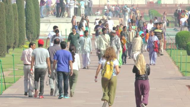 ms shot of tourists and people walking on walkways taj mahal / agra, uttar pradesh, india  - agra stock videos and b-roll footage