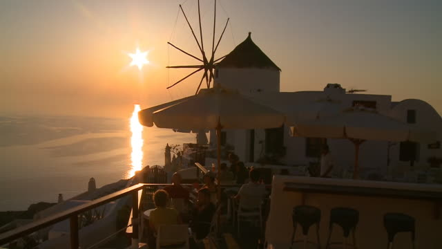 ms shot of tourists at village oia on sun setting / santorini, cyclades, greece - oia santorini stock videos & royalty-free footage