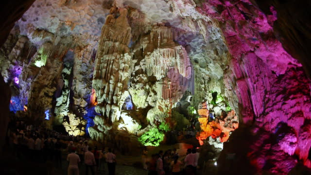 ms shot of tourists in sung sot cave (cave of surprises) / halong bay, vietnam - halong bay stock videos and b-roll footage