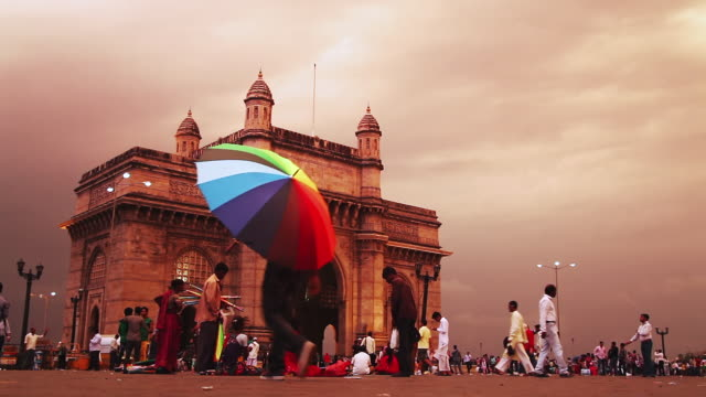 MS Shot of tourists near monument, Gateway Of India / Mumbai, Maharashtra, India