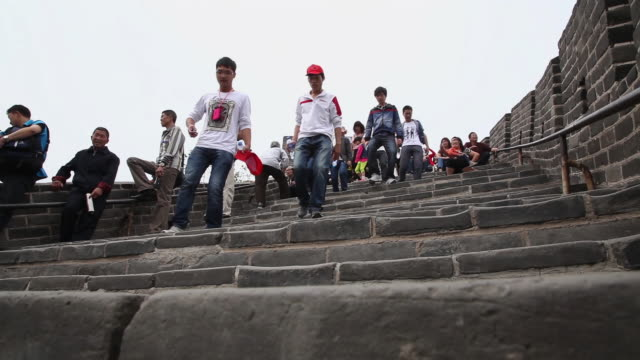 ms la shot of tourists on steps at great wall at badaling / beijing, china - badaling great wall stock videos & royalty-free footage