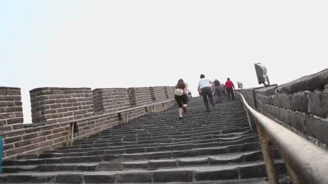 ws la shot of tourists running on steps at great wall at badaling / beijing, china - badaling stock videos & royalty-free footage