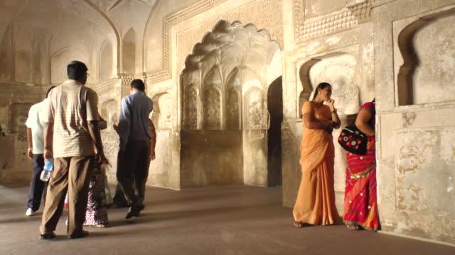 ms shot of tourists walking around hallway at lobby of taj mahal / agra, uttar pradesh, india  - agra video stock e b–roll