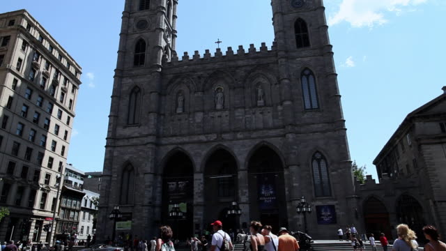 MS TU Shot of Tourists walking in front of Notre-Dame Basilica at sunny day in Old Montreal / Montreal, Quebec, Canada