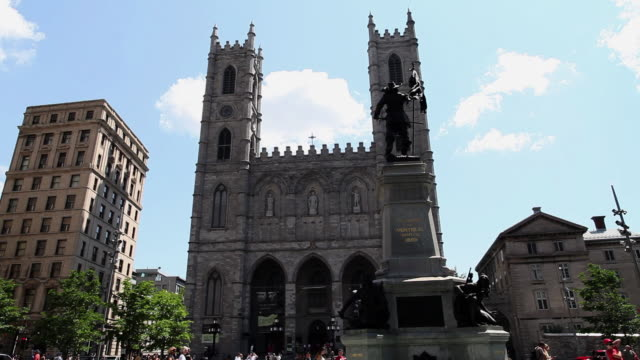 MS TU Shot of Tourists walking in front of Notre-Dame Basilica with Maisonneuve Monument at sunny day in Old Montreal / Montreal, Quebec, Canada
