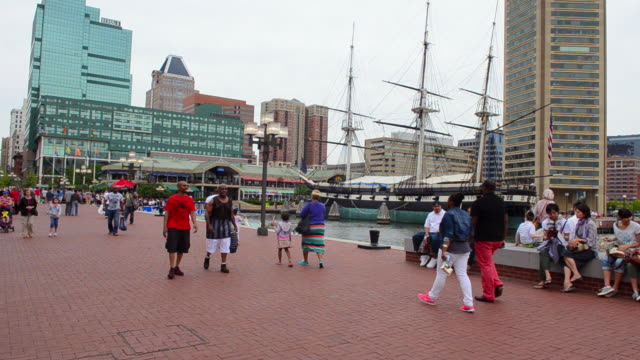 ms shot of tourists walking on chesapeake bay / baltimore, maryland, united states - baltimore maryland bildbanksvideor och videomaterial från bakom kulisserna