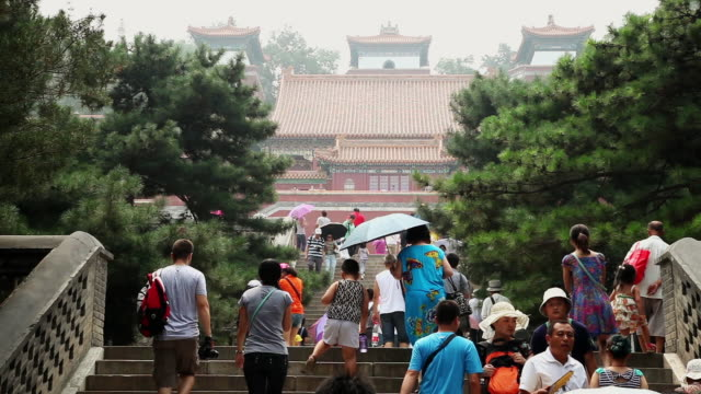 MS Shot of Tourists walking on staircase in Summer Palace / Beijing, China