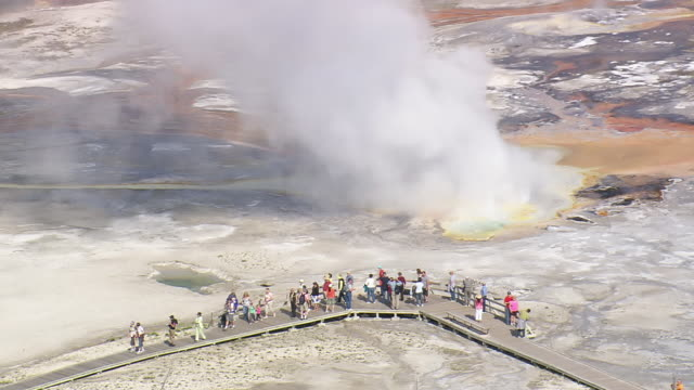 ms aerial shot of tourists walking on walkway near hot water fountain group at yellowstone national park / wyoming, united states - yellowstone national park stock videos & royalty-free footage