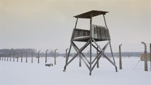 ms shot of tower in auschwitz ii birkenau with snow rain / auschwitz-birkenau, krakow, poland - holocaust stock videos & royalty-free footage
