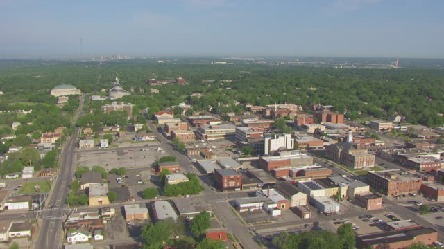 WS AERIAL Shot of town and Community of Christ Auditorium and Temple visible in background / Independence, Missouri, United States