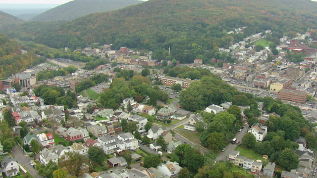 ms aerial shot of town and sign on red yuengling brewery building / pottsville, pennsylvania, united states - pottsville pa stock videos & royalty-free footage