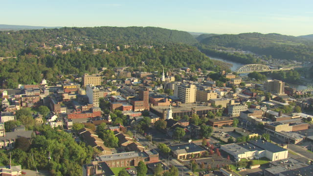 WS AERIAL Shot of town buildings and Lehigh River with Delaware River / Easton, Pennsylvania, United States