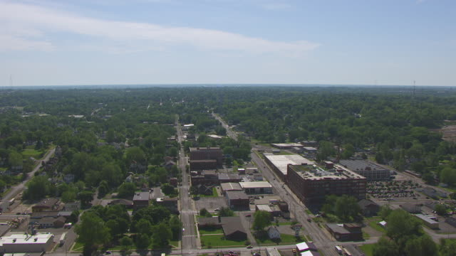 WS AERIAL DS Shot of town buildings / St Joseph, Missouri, United States