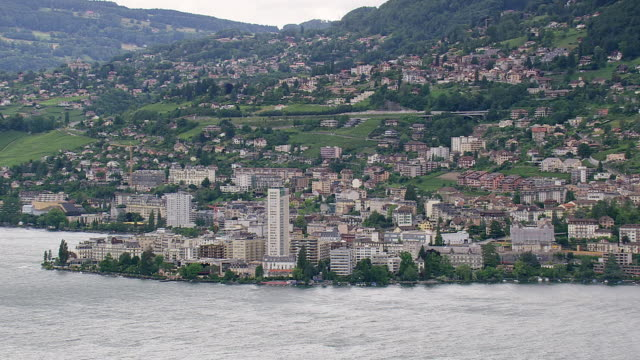 ws aerial shot of town montreux at coast / vaud, switzerland - montreux stock videos and b-roll footage