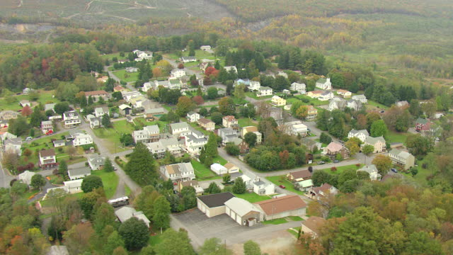 MS AERIAL Shot of town surrounded by woods in Schuylkill County / Pennsylvania, United States
