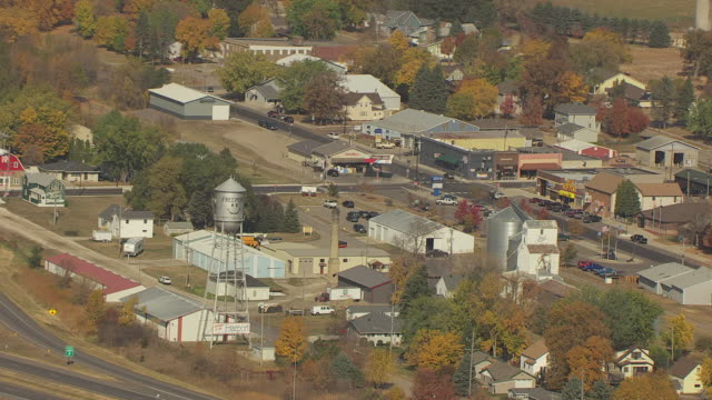 MS AERIAL ZI Shot of town water tower and surrounding businesses / Freeport, Minnesota, United States