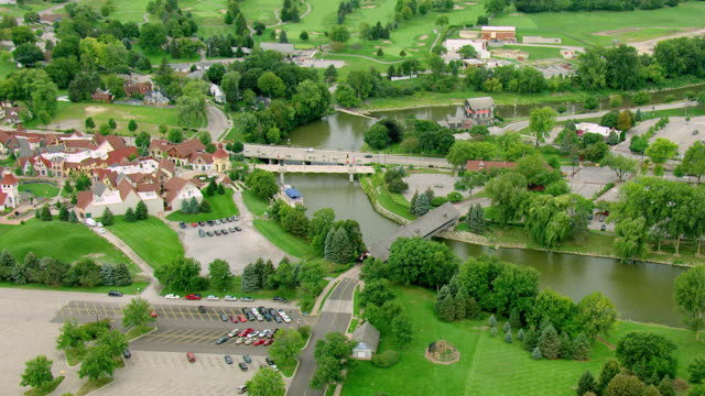 ms aerial shot of town with covered bridge on river / frankenmuth, michigan, united states - michigan stock videos & royalty-free footage
