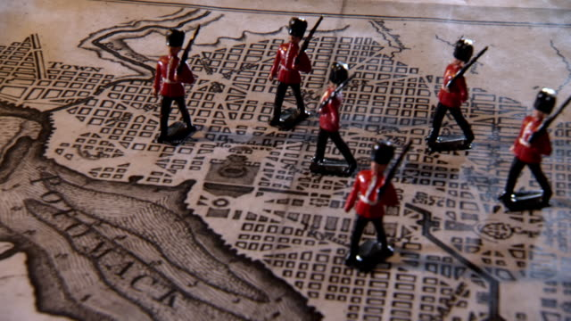 CU PAN Shot of Toy soldiers standing on map of the city of Washington / Alexandria, Virginia, United States