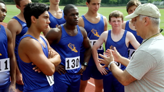 ms shot of track coach gives team pep talk / albany, new york, united states  - manager stock videos & royalty-free footage