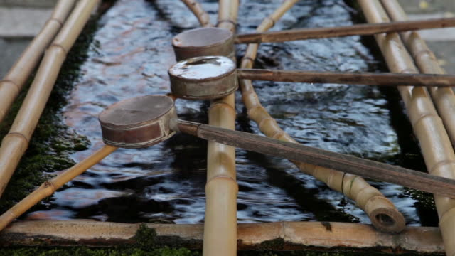 ms shot of traditional water dippers at mitake jinja shinto shrine in autumn at ontakesan district  - tsukubai stock videos and b-roll footage