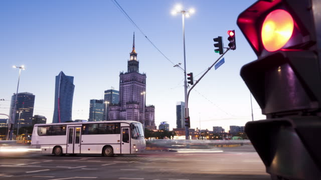 ms t/l shot of traffic and city skyline at dusk / warsaw, masovian voivodeship, poland - warsaw stock videos & royalty-free footage